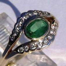 Bezel Set Oval Emerald and diamond Split Shank Ring in 18k Yellow Gold